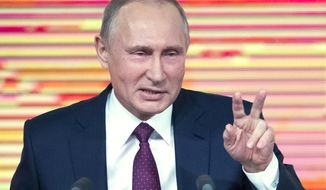 Russian President Vladimir Putin gestures during his annual news conference in Moscow, Russia, Thursday, Dec. 14, 2017. (AP Photo/Pavel Golovkin)