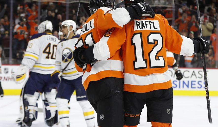 Philadelphia Flyers' Valtteri Filppula, center, of Finland, celebrates his goal with Michael Raffl, right, of Austria, on Buffalo Sabres' Robin Lehner, left, of Sweden, during the second period of an NHL hockey game, Thursday, Dec. 14, 2017, in Philadelphia. (AP Photo/Chris Szagola)