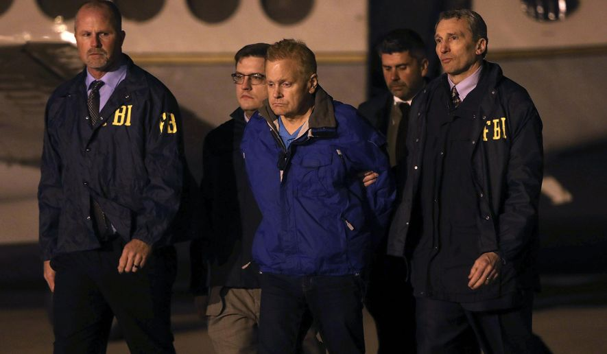 In a Tuesday, Dec. 5, 2017 file photo, fugitive lawyer Eric Conn is taken into custody by FBI agents on the tarmac at Blue Grass Airport in Lexington, Ky.  Conn is facing prosecution on charges he would have avoided if he had not vanished for six months to avoid prison. A federal prosecutor filed court papers signaling the government will try Conn on more than a dozen charges including mail fraud, wire fraud and money laundering. If convicted, Conn could spend the rest of his life in prison. (AP Photo/Matt Goins, File)