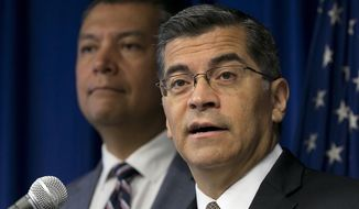 FILE - In this Sept. 5, 2017, file photo, California Attorney General Xavier Becerra, right, flanked by Secretary of State Alex Padilla during a news conference in Sacramento, Calif. Becerra is suing the Trump administration, saying the federal Department of Education is refusing to process debt relief claims from tens of thousands of students who had federal loans to attend Corinthian Colleges. (AP Photo/Rich Pedroncelli, File)