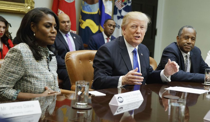 """In this Feb. 1, 2017, file photo, President Donald Trump speaks during a meeting on African American History Month in the Roosevelt Room of the White House in Washington. From left are, Omarosa Manigault, Trump, and then-Housing and Urban Development Secretary-designate Ben Carson. Omarosa Manigault Newman — the former """"Apprentice"""" contestant who became one of Trump's most prominent African -American supporters — has resigned from the White House. (AP Photo/Evan Vucci, File)"""