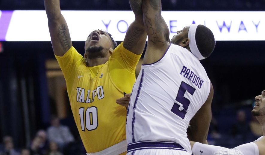 Valparaiso guard/forward Joe Burton, left, shoots against Northwestern center Dererk Pardon during the first half of an NCAA college basketball game Thursday, Dec. 14, 2017, in Rosemont, Ill. (AP Photo/Nam Y. Huh)