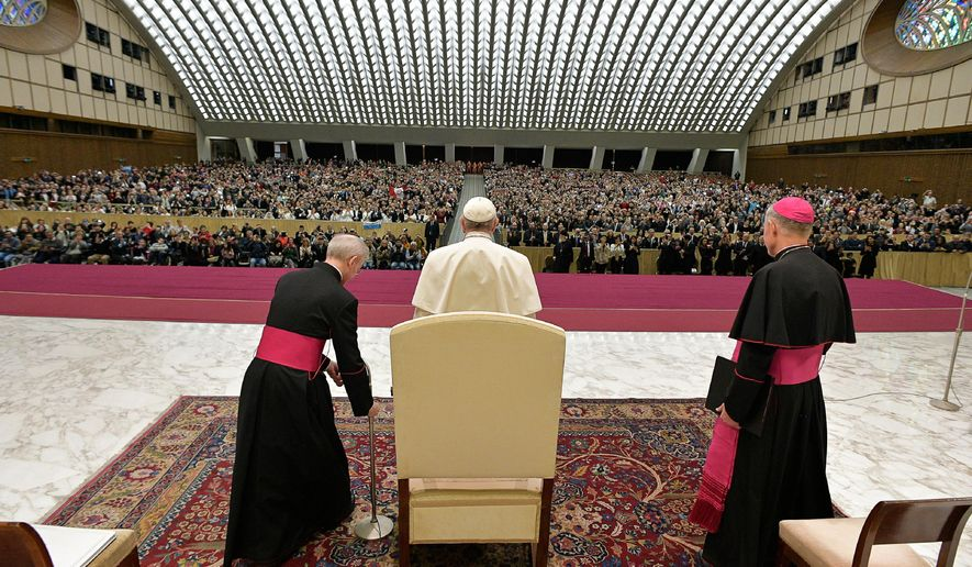 Pope Francis, center, arrives for his weekly general audience in the Paul VI Hall at the Vatican, Wednesday, Dec. 13, 2017. (L'Osservatore Romano/Pool Photo via AP)