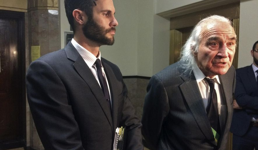 Attorneys Tyler Smith, left, and Tony Serra, right, representing defendants Max Harris and Derick Almena, who face involuntary manslaughter charges in the fire at the Oakland Ghost Ship warehouse last year, speak with reporters outside a courtroom Thursday, Dec. 14, 2017, in Oakland, Calif. A California city fire marshal said Thursday he did not find any records of requests by firefighters to inspect a warehouse where 36 people died in the worst building fire in the U.S. in more than a decade. (AP Photo/Sudhin Thanawala)