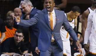 Oklahoma State head coach Mike Boynton Jr. shouts to his team in the second half of an NCAA college basketball game against Wichita State in Stillwater, Okla., Saturday, Dec. 9, 2017. (AP Photo/Sue Ogrocki)