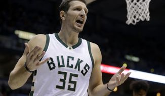 FILE - In this Sunday, Jan. 8, 2017 file photo, Milwaukee Bucks' Mirza Teletovic reacts to a call during an NBA basketball game against the Washington Wizards in Milwaukee. Milwaukee Bucks forward Mirza Teletovic will be out indefinitely because of a blockage in his lungs. The team said Thursday, Dec. 14, 2017 that pulmonary embolisms were discovered in both of Teletovic's lungs.(AP Photo/Aaron Gash, File)
