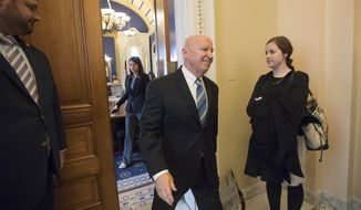 House Ways and Means Committee Chairman Kevin Brady, R-Texas, leaves his office in the Capitol as House Republicans prepare to advance the GOP tax bill, in Washington, Friday, Dec. 15, 2017. (AP Photo/J. Scott Applewhite)