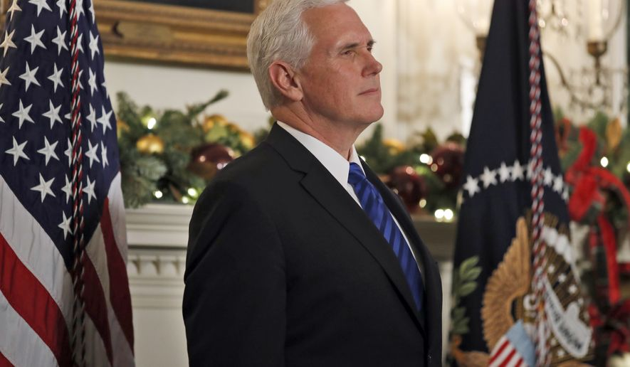In this Dec. 6, 2017, photo, Vice President Mike Pence listens as President Donald Trump speaks in the Diplomatic Reception Room of the White House, Wednesday, Dec. 6, 2017, in Washington. Senior Trump administration officials outlined their view on Dec. 15, that Jerusalem's Western Wall ultimately will be declared a part of Israel, in another declaration sure to enflame passions among Palestinians and others in the Middle East. Although they said the ultimate borders of the holy city must be resolved through Israeli-Palestinian negotiations, the officials, speaking ahead of Pence's trip to the region, essentially ruled out any scenario that didn't maintain Israeli control over the holiest ground in Judaism.  (AP Photo/Alex Brandon)