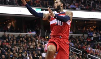 Washington Wizards forward Mike Scott (30) goes to the basket during the second half of an NBA basketball game against the Los Angeles Clippers, Friday, Dec. 15, 2017, in Washington. (AP Photo/Nick Wass)