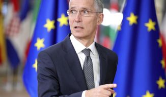 NATO Secretary General Jens Stoltenberg arrives for an EU summit at the Europa building in Brussels on Thursday, Dec. 14, 2017. European Union leaders are gathering in Brussels and are set to move Brexit talks into a new phase as pressure mounts on Prime Minister Theresa May over her plans to take Britain out of the 28-nation bloc. (AP Photo/Olivier Matthys)