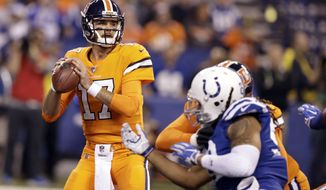 Denver Broncos quarterback Brock Osweiler (17) throws against the Indianapolis Colts during the first half of an NFL football game in Indianapolis, Thursday, Dec. 14, 2017. (AP Photo/Darron Cummings)