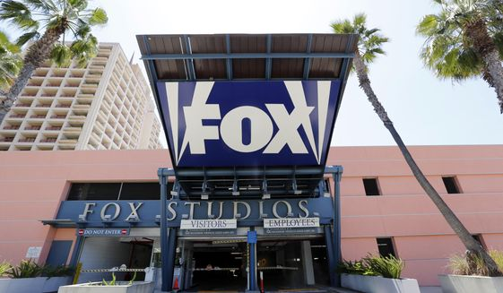 In this Tuesday, May 7, 2013, file photo, an entrance to a parking garage at 20th Century-Fox studios, an entity owned by News Corporation, is seen in Los Angeles. Disney announced Thursday, Dec. 14, 2017, that it is buying a large part of Fox, but the Fox studio lot in Los Angeles will remain with the Murdoch family. (AP Photo/Reed Saxon, File)