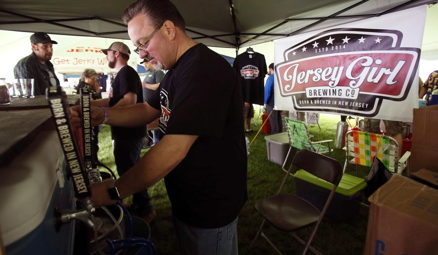 In a May 21, 2016 photo, Chuck Aaron, president and CEO of Jersey Girl Brewing Co., works at New Jersey's only all New Jersey Craft Beer and Food Festival at Lewis Morris Park in Morristown, N.J., as a fundraiser for Eleventh Hour Rescue, a Rockaway-based animal shelter. (The Daily Record via AP)
