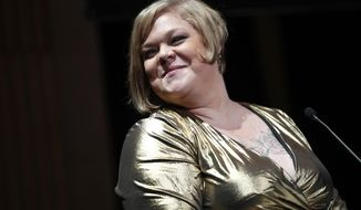 American writer, photographer, and activist, best known for being part of the body positive movement, Jes Baker, delivers a speech during a day against fat phobia in Paris, France, Friday, Dec. 15, 2017. Paris, the seat of global luxury industries and one of the world's most image-conscious cities, is looking at its contradictions in the mirror with rising obesity levels and is launching a campaign against an often disregarded kind of discrimination: sizeism. (AP Photo/Christophe Ena)