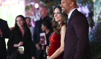 "Dwayne Johnson and Lauren Hashian arrive at the Los Angeles premiere of ""Jumanji: Welcome to the Jungle"" on Monday, Dec. 11, 2017 in Hollywood, Calif. (Photo by Jordan Strauss/Invision/AP)"