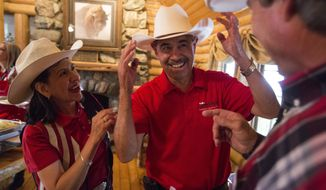 Ogden Pioneer Days Rodeo Grand Marshall, Javier Chevez, owner of Javier's Authentic Mexican Food, and his wife Amada, joke with his longtime friend Jeff Hales, about his odd shaped cowboy hat while hosting a dinner at the hospitality cabin during the Ogden Pioneer Days Rodeo on Thursday, July 20, 2017, at Ogden Pioneer Stadium. (Matt Herp/Standard-Examiner via AP)