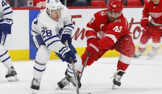 Toronto Maple Leafs right wing Connor Brown (28) battles for the puck with Detroit Red Wings center Henrik Zetterberg (40)  in the first period of an NHL hockey game Friday, Dec. 15, 2017, in Detroit. (AP Photo/Paul Sancya)