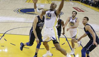 Golden State Warriors' David West (3) drives to the basket against the Dallas Mavericks during the first half of an NBA basketball game Thursday, Dec. 14, 2017, in Oakland, Calif. (AP Photo/Marcio Jose Sanchez)