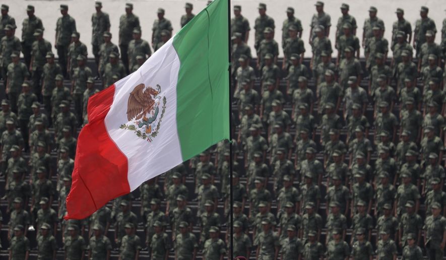 FILE - In this Sept. 13, 2016 photo, cadets attend a graduation ceremony at the Military Academy, in Mexico City. Mexico's Senate approved a law Friday, Dec. 15, 2017, that would give the military legal justification to act as police, despite objections from human rights groups. (AP Photo/Rebecca Blackwell, File)