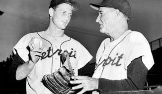 This is an undated photo showing Detroit Tigers pitcher Frank Lary, left, and Tigers manager Bucky Harris. Former star Detroit Tigers pitcher Frank Lary has died at 87. Nephew Joe Lary says the Northport, Alabama, native died Wednesday night after being hospitalized in Tuscaloosa with pneumonia. (Detroit News via AP)