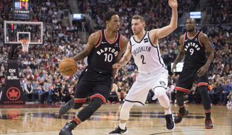 Toronto Raptors guard DeMar DeRozan (10) drives to the net against Brooklyn Nets guard Nik Stauskas (2) as Raptors forward Serge Ibaka (9) looks on during second-half NBA basketball game action in Toronto, Friday, Dec. 15, 2017. (Frank Gunn/The Canadian Press via AP)
