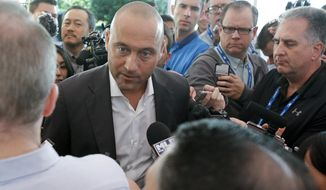 FILE - In this Nov. 15, 2017, file photo, Derek Jeter, chief executive officer and part owner of the Miami Marlins, talks with members of the media at the annual  baseball general managers' meetings, in Orlando, Fla. Jeter, The Player, glided through two decades in the Big Apple. Suave, sophisticated and charming, he made it all look so effortless, a beloved figure who could seemingly do no wrong, even in the media cauldron that is New York City. Which makes Derek Jeter, The Baseball Executive, all the more baffling.(AP Photo/John Raoux, File)