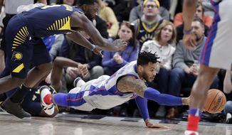 Detroit Pistons forward Eric Moreland (24) dives for a loose ball under Indiana Pacers guard Lance Stephenson (1) during the second half of an NBA basketball game in Indianapolis, Friday, Dec. 15, 2017. The Pistons defeated the Pacers 104-98. (AP Photo/Michael Conroy)