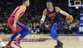 Oklahoma City Thunder's Russell Westbrook, right, looks to make his move on Philadelphia 76ers' Ben Simmons, left, of Australia, during the first half of an NBA basketball game, Friday, Dec. 15, 2017, in Philadelphia. (AP Photo/Chris Szagola)