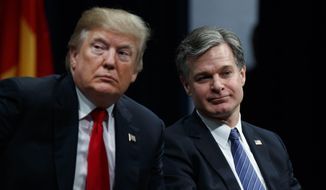 President Donald Trump sits with FBI Director Christopher Wray during the FBI National Academy graduation ceremony, Friday, Dec. 15, 2017, in Quantico, Va. (AP Photo/Evan Vucci) ** FILE **