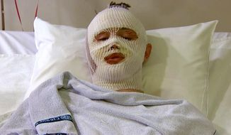 """FILE - In this March 25, 2016 file still image from video, Mason Wells, an American survivor of the attacks in Belgium, answers questions during an interview in a hospital in Ghent, Belgium. Wells also was in Boston at the time of the 2013 Boston Marathon bombings, having gone to support his mother during her race. On Friday, Dec. 15, 2017, the 20-year-old missionary from Sandy, Utah, released a video addressing the attackers, where he said, """"But I have chosen to forgive you. I have learned that the decision to forgive is ours and ours alone."""" (Pool TV via AP, File)"""