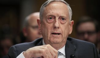 FILE - In this Oct. 30, 2017, file photo, Secretary of Defense Jim Mattis testifies on Capitol Hill in Washington. Mattis is warning against dangerous flights by Russian fighter jets over what is considered a safe zone in Syria, questioning whether recent incidents were mistakes or deliberately unwise maneuvers. Mattis tells Pentagon reporters that the U.S. and Russia are still using a phone line to deconflict flights over the crowded Syrian skies as the U.S.-led coalition goes after remaining Islamic State militants. (AP Photo/Manuel Balce Ceneta, File)