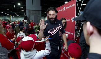 Washington Nationals pitcher Tanner Roark greets fans during the Winter Fest celebration with fans at Washington Convention Center in Washington, Saturday, Dec. 16, 2017. ( AP Photo/Jose Luis Magana)