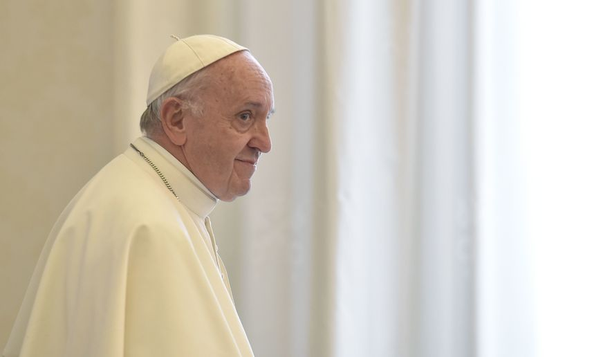 Pope Francis stands during the audience with  Ecuador's President Lenin Moreno at the Vatican, Saturday, Dec. 16, 2017. (Andreas Solaro/Pool Photo via AP)