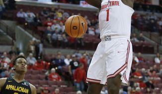 Ohio State forward Jae'Sean Tate, right, dunks against Appalachian State forward Isaac Johnson during the first half of an NCAA college basketball game in Columbus, Ohio, Saturday, Dec. 16, 2017. (AP Photo/Paul Vernon)