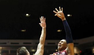 Arizona's Ira Lee, right, shoots the ball over New Mexico's Dane Kuiper in the first half of an NCAA college basketball game, Saturday, Dec. 16, 2017, in Albuquerque, N.M. (AP Photo/Eric Draper)