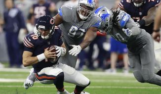 Detroit Lions defensive tackle Akeem Spence (97) sacks Chicago Bears quarterback Mitchell Trubisky (10) during the second half of an NFL football game, Saturday, Dec. 16, 2017, in Detroit. (AP Photo/Rey Del Rio)
