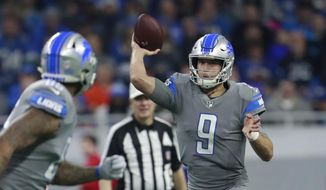 Detroit Lions quarterback Matthew Stafford (9) throws to tight end Eric Ebron during the first half of an NFL football game against the Chicago Bears, Saturday, Dec. 16, 2017, in Detroit. (AP Photo/Rey Del Rio)