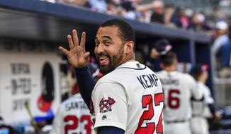 FILE - In this June 24, 2017, file photo, Atlanta Braves' Matt Kemp waves to a fan after the team's baseball game against the Milwaukee Brewers in Atlanta. Kemp is returning to the Los Angeles Dodgers as part of a five-player trade with the Atlanta Braves that includes cash. (AP Photo/Danny Karnik, File) **FILE**