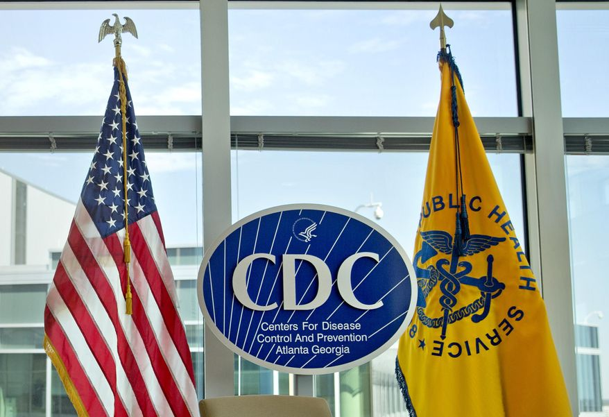 This Nov. 19, 2013 file photo shows a Centers for Disease Control and Prevention logo at the agency's federal headquarters in Atlanta.  (AP Photo/David Goldman, File) **FILE**