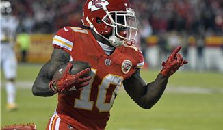 Kansas City Chiefs wide receiver Tyreek Hill (10) scores a 64-yard touchdown during the first half of an NFL football game against the Los Angeles Chargers in Kansas City, Mo., Saturday, Dec. 16, 2017. (AP Photo/Ed Zurga)