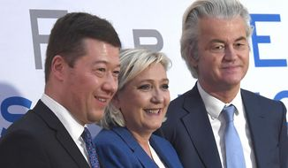 From the left founder and President of Czech Freedom and Direct Democracy  party Tomio Okamura, French politician and head  of the National Front, Marine Le Pen, and Dutch politician, founder and the current leader of the Party for Freedom Geert Wilders pose for photographers after a press conference  at a conference of European anti-migrant parties from the Europe of Nations and Freedom (ENF) Group in the European Parliament, in Prague, Saturday, Dec. 16, 2017. (Michal Krumphanzl/CTK via AP)