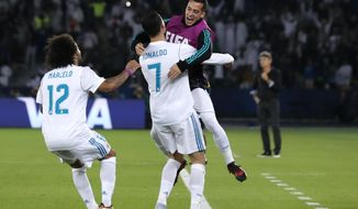 Real Madrid's Cristiano Ronaldo celebrates with teammate Lucas Vazquez, right, after scoring the opening goal during the Club World Cup final soccer match between Real Madrid and Gremio at Zayed Sports City stadium in Abu Dhabi, United Arab Emirates, Saturday, Dec. 16, 2017. (AP Photo/Hassan Ammar)