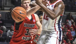 Illinois State's Taylor Bruninga (32) knocks the ball away from Mississippi's Bruce Stevens (12) during an NCAA college basketball game, in Oxford, Miss., on Saturday, Dec. 16, 2017. (Bruce Newman/The Oxford Eagle via AP)