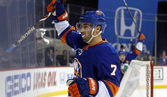 New York Islanders center Jordan Eberle reacts after scoring the game winning goal in overtime of an NHL hockey game against the Los Angeles Kings, Saturday, Dec. 16, 2017, in New York. The Islanders won 4-3. (AP Photo/Adam Hunger)