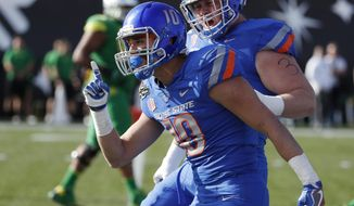 Boise State safety Kekoa Nawahine celebrates after making a tackle for a loss for Oregon during the first half of the Las Vegas Bowl NCAA college football game Saturday, Dec. 16, 2017, in Las Vegas. (AP Photo/John Locher)