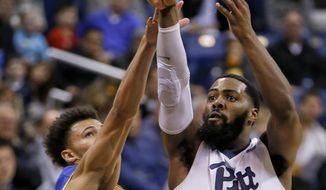 Pittsburgh's Jared Wilson-Frame (0) shoots for three over McNeese State's Jacob Ledoux in the first half of an NCAA college basketball game, Saturday, Dec. 16, 2017, in Pittsburgh. (AP Photo/Keith Srakocic)