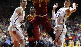 Iowa State guard Lindell Wigginton (5) drives to the basket between Northern Iowa's Bennett Koch, left, and Wyatt Lohaus, right, during the first half of an NCAA college basketball game, Saturday, Dec. 16, 2017, in Des Moines, Iowa. (AP Photo/Charlie Neibergall)