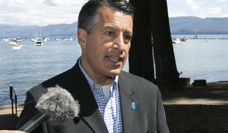 "FILE - In this Aug. 22, 2017 file photo, Nevada Gov. Brian Sandoval talks with reporter following the 21st Annual Lake Tahoe Summit in South Lake Tahoe, Calif.  Sandoval says he and his wife, Kathleen, have decided to separate and plan to divorce after 27 years of marriage.  The two-term Republican says in a statement released Friday, Dec. 15,  that ""demands of public life are hard on a marriage and ours has been affected in a way neither of us had envisioned or expected.""(AP Photo/Rich Pedroncelli)"