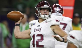 Troy quarterback Brandon Silvers (12) passes in the first half of the New Orleans Bowl NCAA college football game against North Texas in New Orleans, Saturday, Dec. 16, 2017. (AP Photo/Gerald Herbert)
