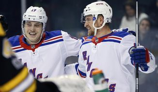 New York Rangers' Michael Grabner, of Austria, right, celebrates his goal with Jesper Fast (17), of Sweden, during the first period of an NHL hockey game against the Boston Bruins in Boston, Saturday, Dec. 16, 2017. (AP Photo/Michael Dwyer)